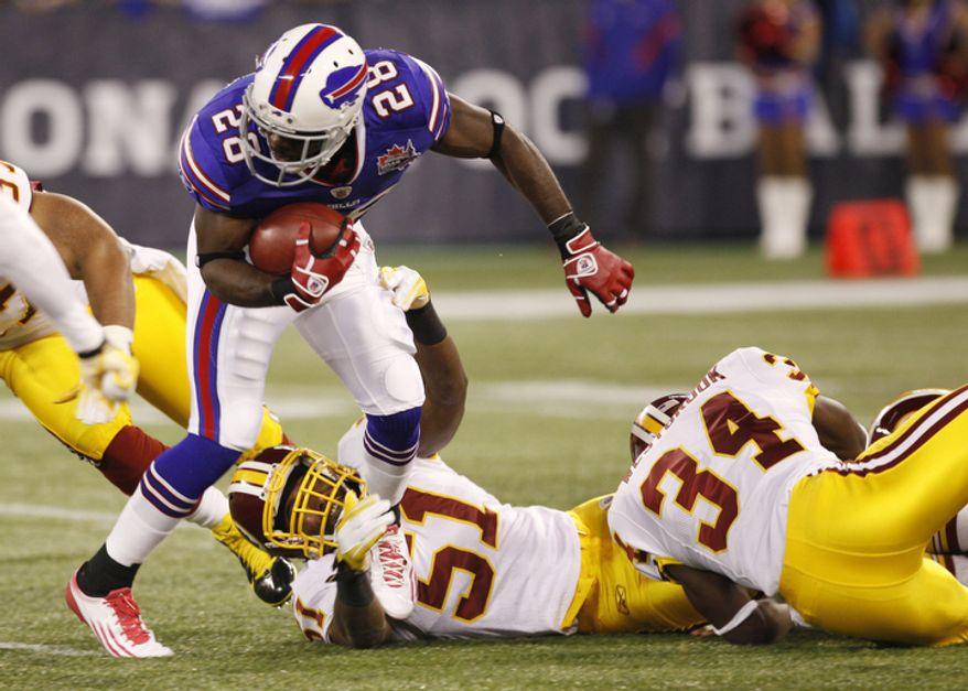 Buffalo Bills' C.J. Spiller (28) is tackled by Washington Redskins' Keyaron Fox (51) during the first quarter of an NFL football game at the Rogers Centre in Toronto, Sunday, Oct. 30, 2011. (AP Photo/Derek Gee)