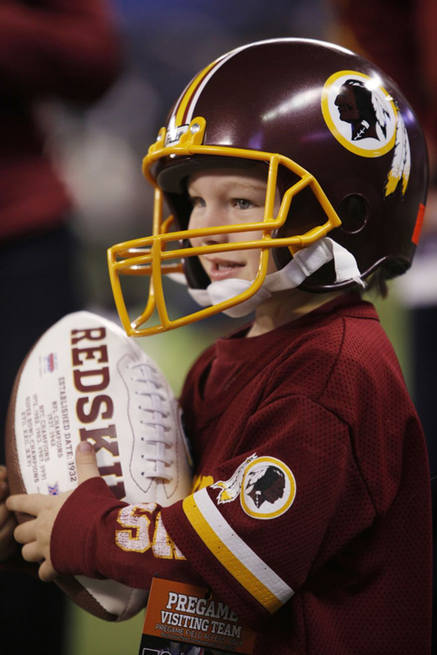 A pint-sized Washington Redskins fan watches warmups before an NFL football game against the Buffalo Bills at the Rogers Centre in Toronto, Sunday, Oct. 30, 2011. (AP Photo/Derek Gee)