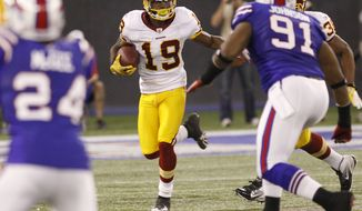 Washington Redskins' Donte Stallworth (19) looks for an opening after a catch against the Buffalo Bills during the first quarter of an NFL football game at the Rogers Centre in Toronto, Sunday, Oct. 30, 2011. (AP Photo/Derek Gee)