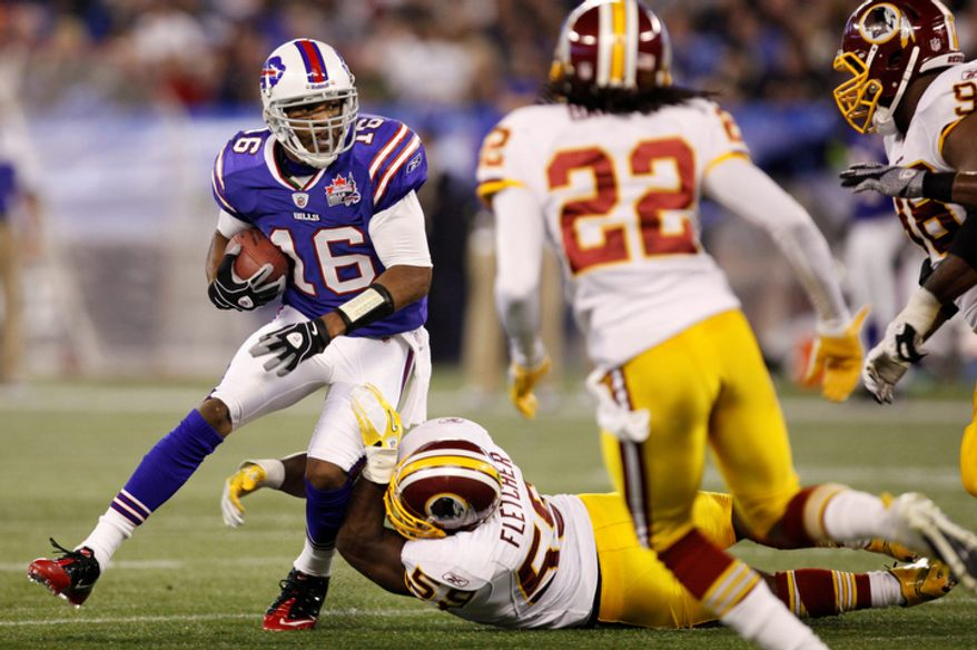 Buffalo Bills' Brad Smith (16) tries to evade Washington Redskins' London Fletcher, bottom, during the first half of an NFL football game, in Toronto on Sunday, Oct. 30, 2011. (AP Photo/Derek Gee)