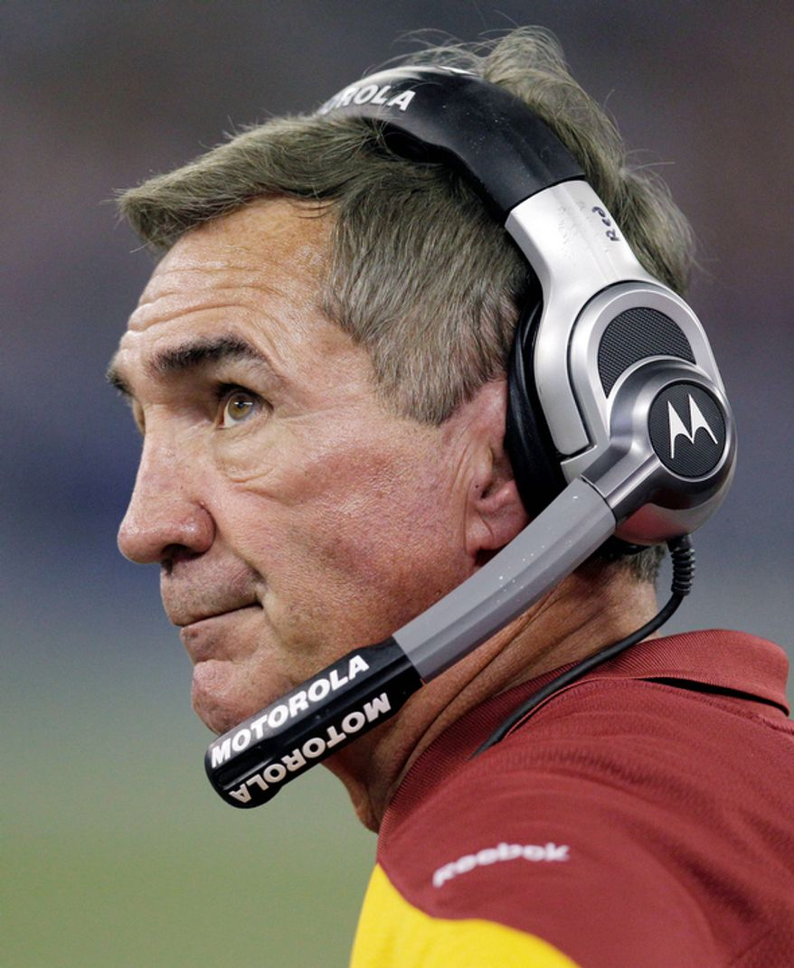 Washington Redskins coach Mike Shanahan looks on during the fourth quarter of an NFL football game against the Buffalo Bills in Toronto on Sunday, Oct. 30, 2011. The Bills won 23-0. (AP Photo/David Duprey)