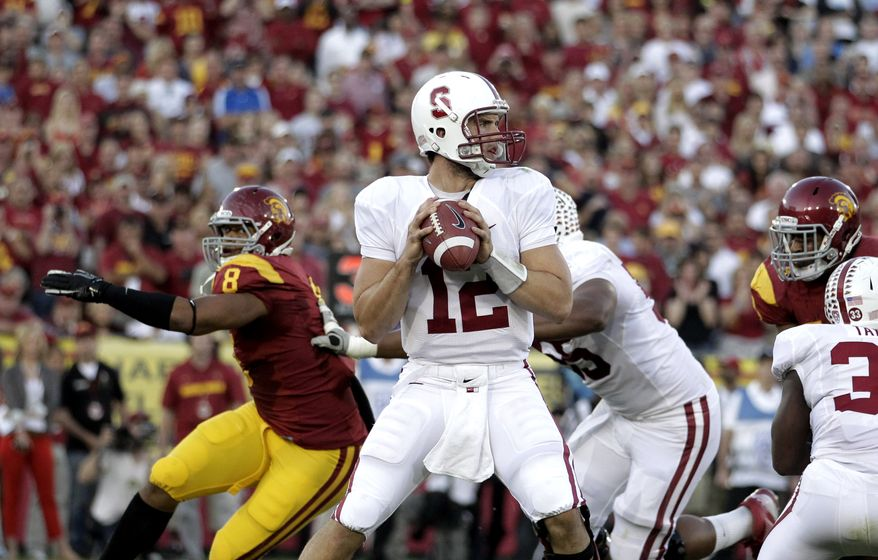 Stanford quarterback Andrew Luck, center, looks to pass during the first half against Southern California in Los Angeles, Saturday, Oct. 29, 2011. Stanford won 56-48 in triple overtime. Luck passed for 325 yards and three touchdowns and ran for a key score. (AP Photo/Jae C. Hong)