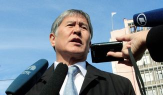 Almazbek Atambayev claims victory Monday after preliminary results show he received more than 60 percent of the vote in Kyrgyzstan's presidential election, but opponents cried foul and refuse to concede defeat. (Associated Press)