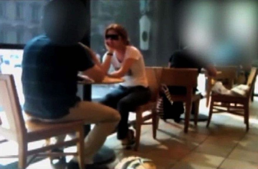 In this frame grab image from a surveillance video released by the Federal Bureau of Investigation, and partially obscured by the source, Russian spy Anna Chapman, wearing sunglasses, sits in a coffee shop in New York. Chapman was one of 10 Russian spies rounded up by the FBI last year. (FBI via Associated Press)