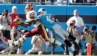 Tight end Fred Davis, shown against Carolina on Oct. 23, leads the Redskins in receptions (36) and receiving yards (517). His status for Sunday's game against San Francisco is unknown because of a sprained ankle. (Associated Press)