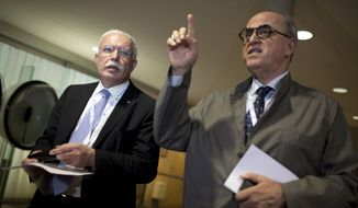 Palestinian Foreign Minister Riad al-Maliki (left) and Elias Sanbar, ambassador for Palestine at UNESCO, attend a session of UNESCO's 36th General Conference in Paris on Monday, Oct. 31, 2011. (AP Photo/Thibault Camus)