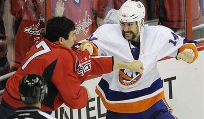 **FILE** Washington Capitals right wing D.J. King (17) fights with New York Islanders left wing Trevor Gillies (14) during the first period of the Capitals' 2-1 home win on Oct. 13, 2010. (Associated Press)