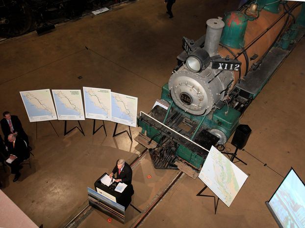 Standing in front of an old steam locomotive at the California Railroad Museum in Sacramento, Calif., on Tuesday, Tom Unberg, chairman of the California High-Speed Rail Authority, discusses the system's 20-year, nearly $100 billion business plan. (Associated Press)