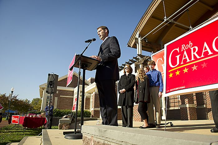 With his wife Cindy, his daughters Erica, 10, and Alyssa,11, and son Jonathan,13, looking on at right Maryland Senate Majority Leader Rob Garagiola (D) delivers his speech as he makes an appearance to announce his campaign for Congress in Maryland's sixth Congressional District, at the BlackRock Center for the Arts in Germantown, Md, Tuesday, November 1, 2011. (Photo/Rod Lamkey Jr./The Washington Times)