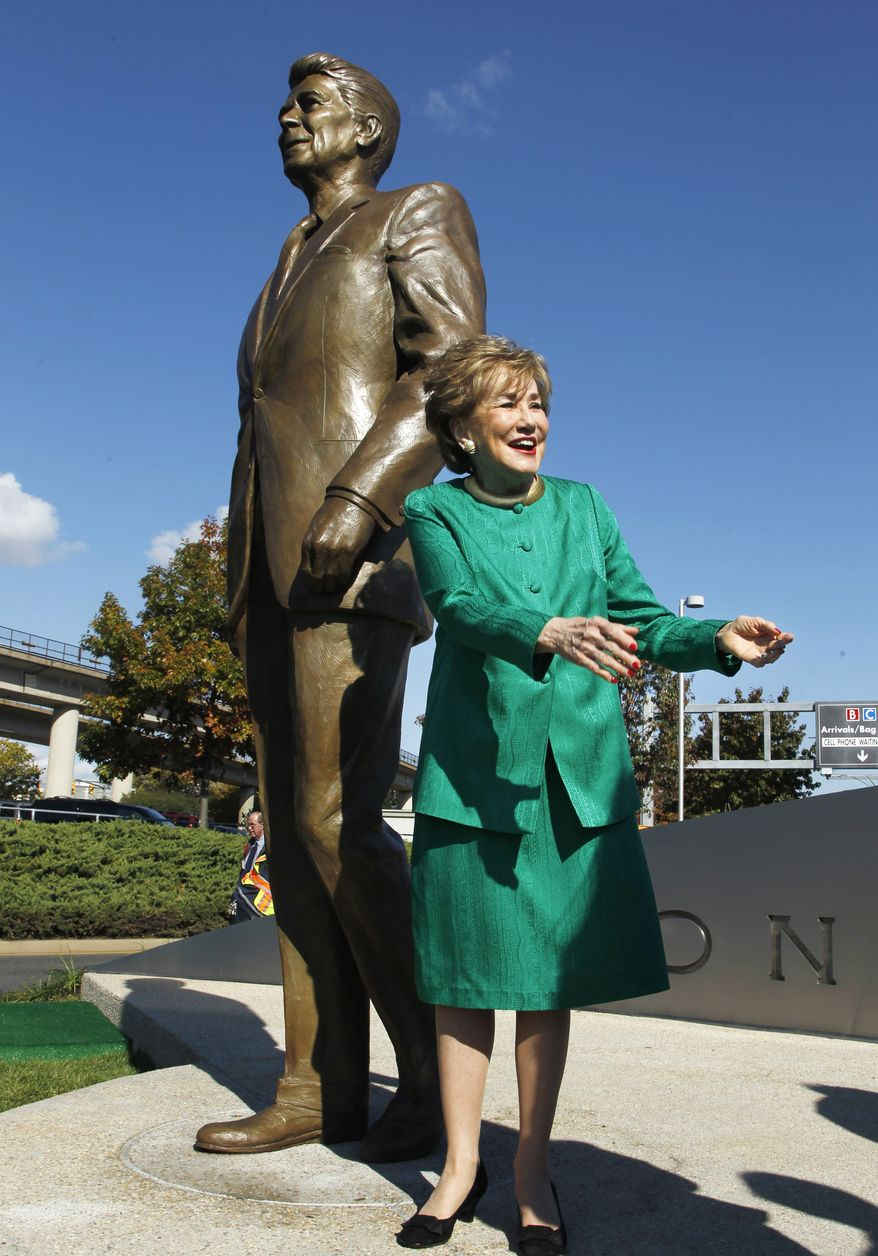 Elizabeth Dole, who served as the Transportation Secretary under President Ronald Reagan, greets guests Nov. 1, 2011, at the unveiling of a statue of Reagan at Washington's Ronald Reagan National Airport. (Associated Press