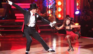 """David Arquette and partner Kym Johnson perform on """"Dancing with the Stars."""" The pair were eliminated Tuesday, but he said he """"loved"""" participating. (Associated Press)"""