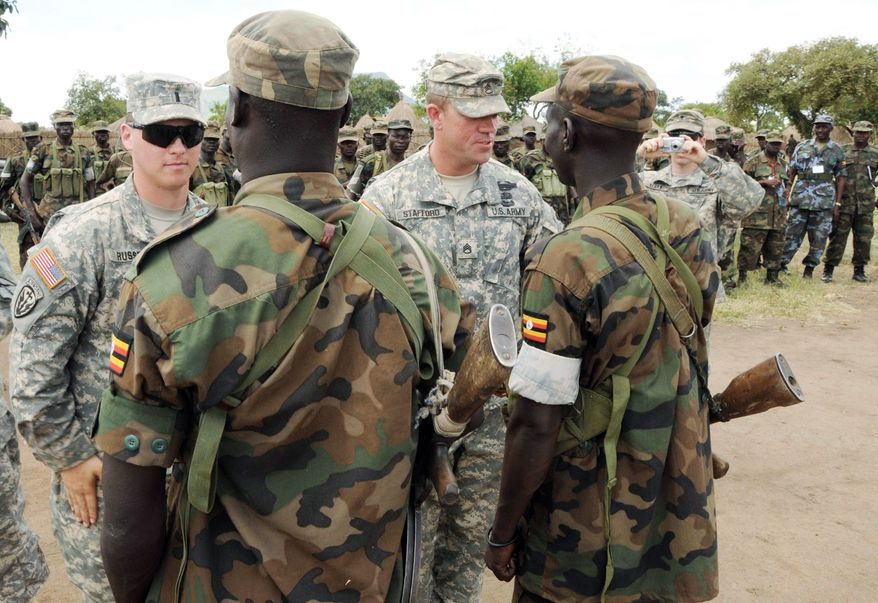 U.S. Army soldiers and Uganda People's Defense Force soldiers participate in a closing ceremony for operation Atlas Drop 11, an annual joint aerial delivery exercise, in Soroti, Uganda, in April. While putting few U.S. troops at risk, the United States is providing intelligence and training to fight militants across the continent, from Mauritania in the west along the Atlantic Ocean, to Somalia in the east along the Indian Ocean. (Associated Press)