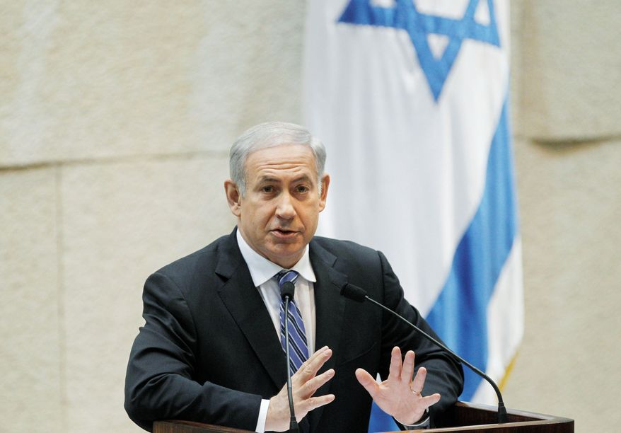 "WARNING: Israeli Prime Minister Benjamin Netanyahu says a nuclear Iran would be a ""grave threat"" and is trying to persuade his Cabinet to support a pre-emptive attack. (Associated Press)"