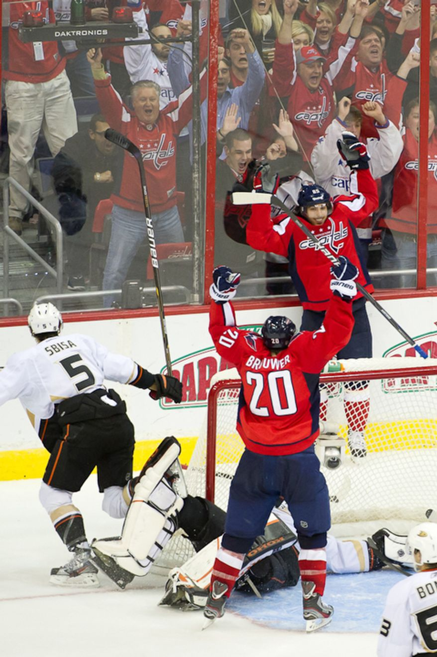 ** FILE ** Mathieu Perreault (85) celebrates as Troy Brouwer (20) of the Washington Capitals scores a goal in the third period against goalie Jonas Hiller (1) of the Anaheim Ducks to bring the score to 3-4 in NHL Hockey at the Verizon Center, Washington, D.C., Tuesday, Nov. 1,  2011. (Andrew Harnik/The Washington Times)