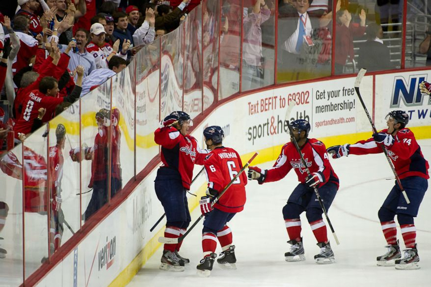 Nicklas Backstrom (19), left, of the Washington Capitals ties the game at 4-4 at the end of the 3rd period to send the game to overtime against the Anaheim Ducks in NHL Hockey at the Verizon Center, Washington, DC, Tuesday, November 1,  2011. (Andrew Harnik / The Washington Times)