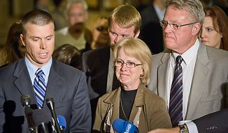 David, right, and Phyllis, center, Murray, the parents of the Lululemon Athletica employee murder victim Jayna Murray listen as their son Hugh Murray, left, speak to reporters after the murder suspect in the case, Brittany Norwood, in found guilty at the Montgomery County Circuit Court, Rockville, MD, Wednesday, November 2,  2011. (Andrew Harnik / The Washington Times)