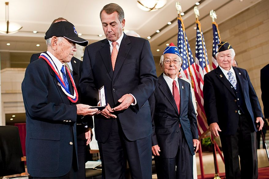 House Speaker John Boehner (R-Ohio), second from left, presents a Congressional Gold Medal to Mitsuo Hamasu, representing the 100th Infantry Battalion, from left, Susumu Ito, representing the 442nd Regimental Combat Team, and Grant Ichikawa, representing the Military Intelligence Service, during a ceremony honoring Japanese-American veterans for their service in WWII in the Capitol Visitors Center in Washington, D.C. on Nov. 2, 2011. (T.J. Kirkpatrick/ The Washington Times)