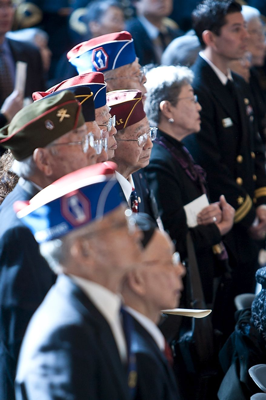 Japanese-American veterans from the 100th Infantry Battalion, 442nd Regimental Combat Team, and the Military Intelligence Service attend a Congressional Gold Medal ceremony honoring the veterans for their service in WWII in the Capitol Visitors Center in Washington, D.C. on Nov. 2, 2011. (T.J. Kirkpatrick/ The Washington Times)