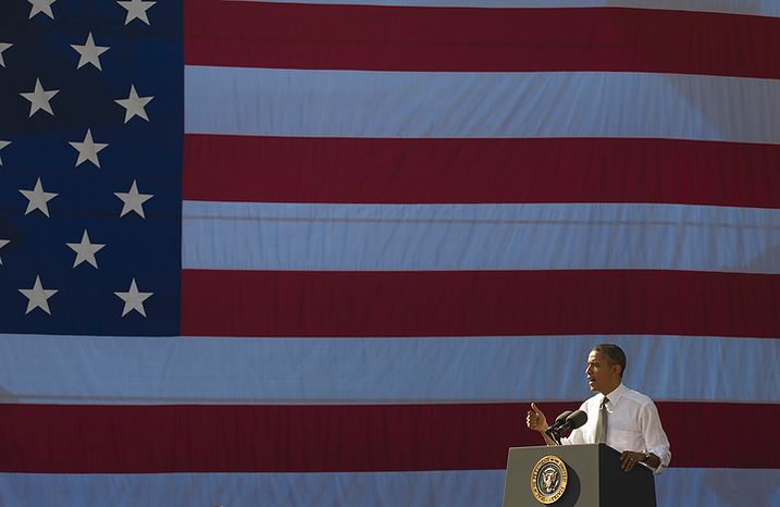 President Obama urges Congress to pass the infrastructure part of the American Jobs Act in a speech to an audience that included ironworkers and steamfitters at Georgetown Waterfront Park in Washington on Wednesday, Nov. 2, 2011. (Rod Lamkey Jr./The Washington Times)