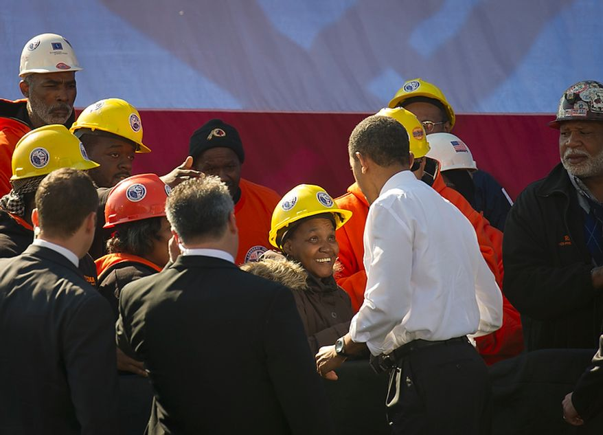 President Obama shakes hands with some in the crowd who heard him speak at Georgetown Waterfront Park in Washington on Wednesday, Nov. 2, 2011. The president urged Congress to pass the infrastructure part of the American Jobs Act. (Rod Lamkey Jr./The Washington Times)