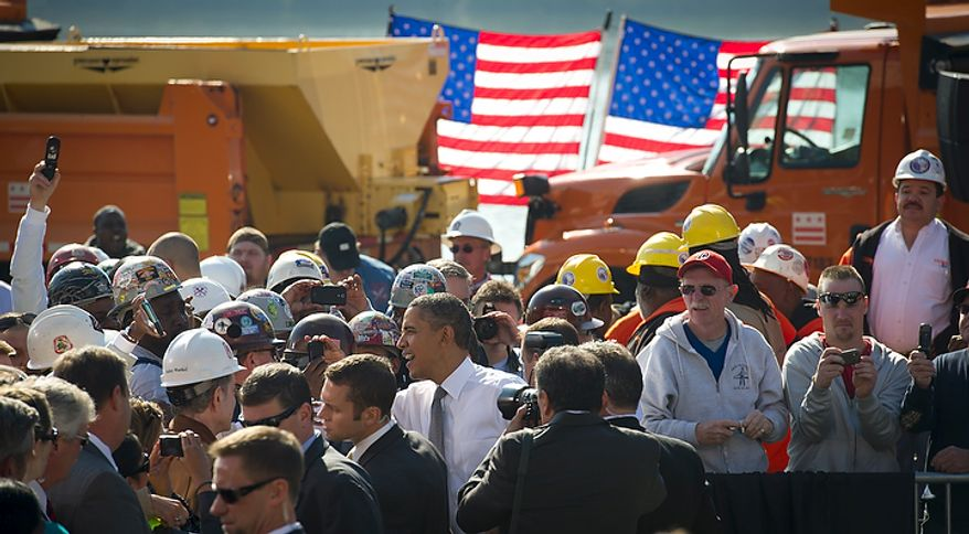 President Obama shakes hands with people in a crowd that included ironworkers and steamfitters after he offered remarks urging Congress to pass the infrastructure part of the American Jobs Act at Georgetown Waterfront Park in Washington on Wednesday, Nov. 2, 2011. (Rod Lamkey Jr./The Washington Times)