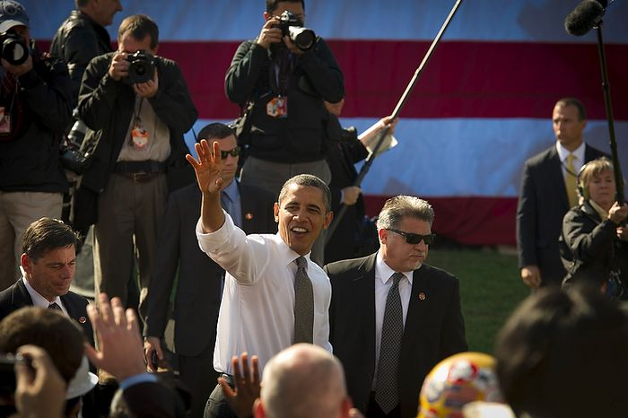 President Obama waves goodbye to a crowd that included ironworkers and steamfitters following his speech urging Congress to pass the infrastructure part of the American Jobs Act, at Georgetown Waterfront Park in Washington on Wednesday, Nov. 2, 2011. (Rod Lamkey Jr./The Washington Times)