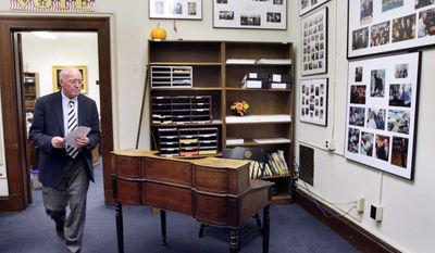 New Hampshire Secretary of State Bill Gardner walks by the historic desk where presidential candidates file their paperwork to be on the nation's first presidential primary ballot, in Concord, N.H., on Wednesday, Oct. 19, 2011. (AP Photo/Jim Cole)