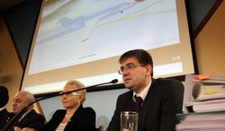 Alexei Morozov (right), a member of the technical commission of Russia's Interstate Aviation Committee, speaks during news conference on Wednesday, Nov. 2, 2011. (AP Photo/Sergey Ponomarev)