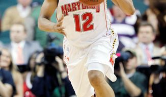 Maryland's Terrell Stoglin, shown during the ACC tournament last season, will split time at point guard with Nick Faust as Pe'Shon Howard recovers from a broken foot. (Associated Press)