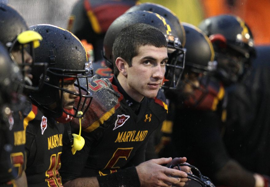 Maryland quarterback Danny O'Brien looks on from the bench in the second half of the game against Boston College in College Park, Md., on Oct. 29, 2011. O'Brien is likely to share snaps with C.J. Brown against Virginia on Saturday. (Associated Press)