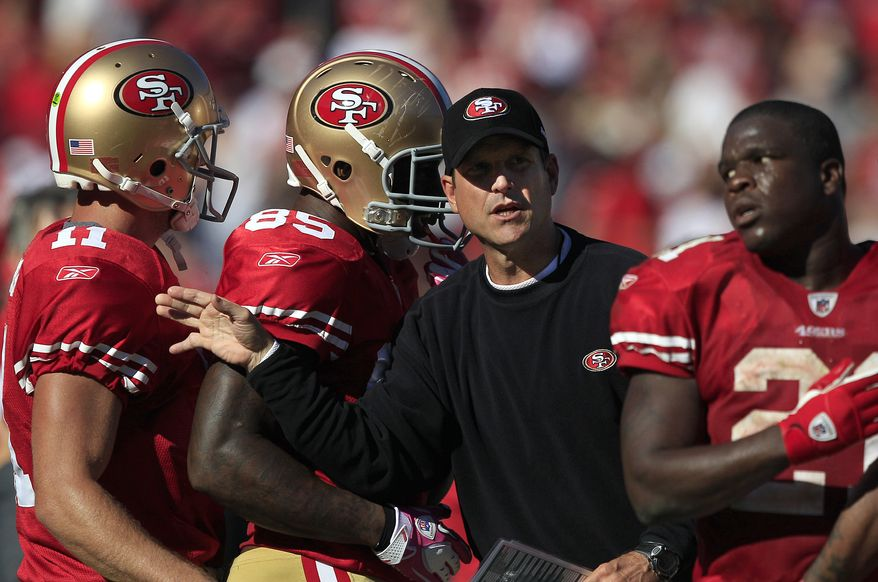 San Francisco 49ers head coach Jim Harbaugh, who quarterbacked for 14 seasons, has his team off to the second best record in the NFC at 6-1. (AP Photo/Marcio Jose Sanchez)