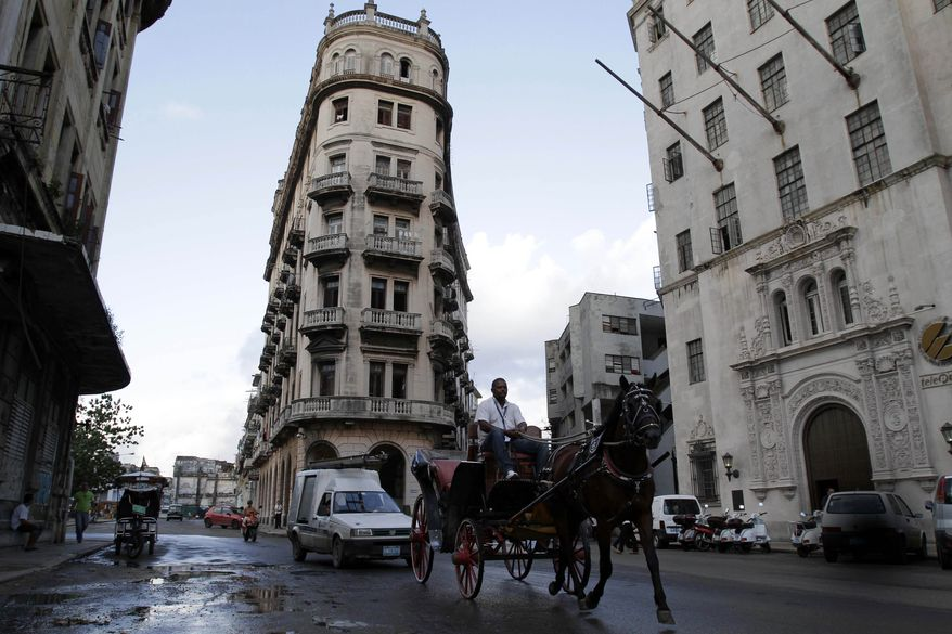 A man drives a horse and carriage in Old Havana, Cuba, on Nov. 3, 2011. (Associated Press)
