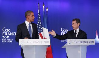 President Obama (left) and French President Nicolas Sarkozy make statements to reporters at the G-20 summit in Cannes, France, on Thursday, Nov. 3, 2011. (AP Photo/Charles Dharapak)