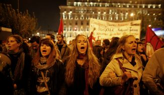 Protesters chant slogans in front of the Greek Parliament during an anti-austerity protest in Athens on Nov. 3 2011. (Associated Press)