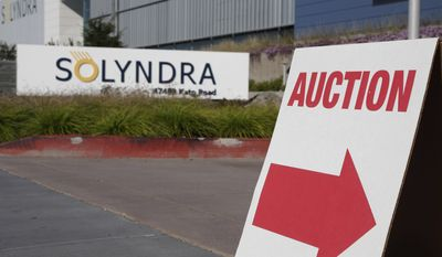 **FILE** An auction sign is shown outside the Fremont, Calif., headquarters for bankrupt solar company Solyndra headquarters on Oct. 31, 2011, before the auction on the following day. Solyndra received a $500 million loan guarantee from the government before filing for bankruptcy in September. (Associated Press)