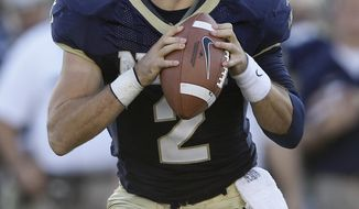Navy quarterback Kriss Proctor dislocated his elbow Oct. 1 against Air Force, and three weeks later he dislocated it again and could not play last week against Notre Dame. He's doing what it takes to try to get back on the field for Saturday's game against Troy, and Mids coach Ken Niumatalolo is prepared to make a game-time decision, if necessary, on the day's starter. (AP Photo/Patrick Semansky)