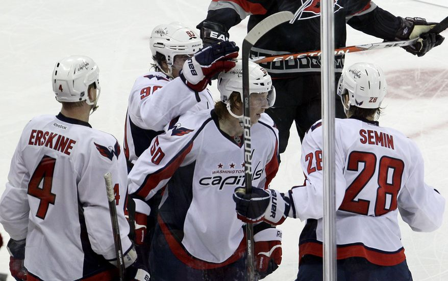 Washington Capitals' Cody Eakin scored his first NHL goal and recorded his first assist Friday night against the Carolina Hurricanes, in his second career game. (AP Photo/Gerry Broome)