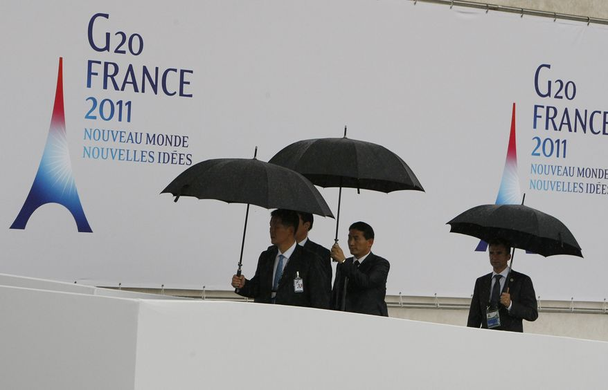 **FILE** Delegates arrive Nov. 4, 2011, for the day's first working session at the G20 summit in Cannes. (Associated Press)