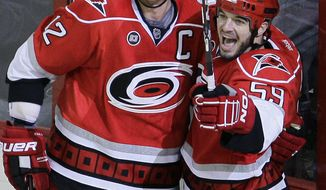 Carolina Hurricanes' Eric Staal is a minus-12 with three goals and two assists in 12 games this season. (AP Photo/Gerry Broome)