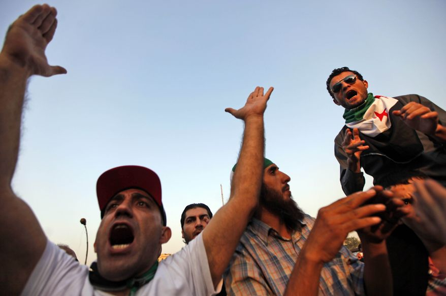 Protesters chant slogans Nov. 2, 2011, during a demonstration against the Syrian regime, held in front of the Arab league headquarters in Cairo. (Associated Press)
