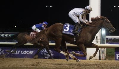 Mike Smith riding Drosselmeyer races in front of Chantal Sutherland riding Game On Dude to win the Classic race at the Breeders' Cup horse races at Churchill Downs Saturday, Nov. 5, 2011, in Louisville, Ky. (AP Photo/Morry Gash)