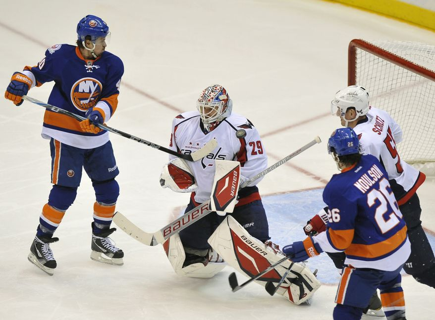 Washington Capitals goalie Tomas Vokoun made 30 saves, but took the blame for three of the four goals he allowed against the New York Islanders on Saturday night. (AP Photo/Kathy Kmonicek)