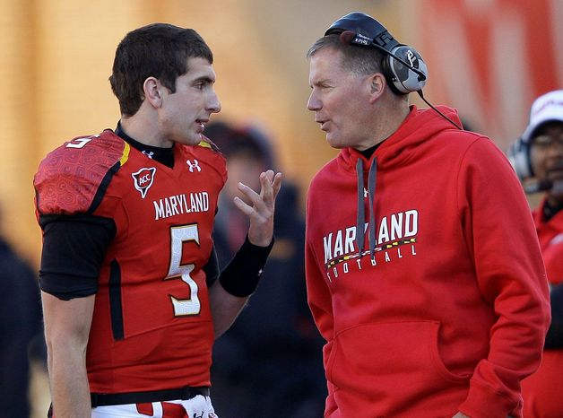 Maryland quarterback Danny O'Brien and coach Randy Edsall talk on the sideline after O'Brien threw an interception during the Terrapins' 31-13 loss to Virginia. (Associated Press)