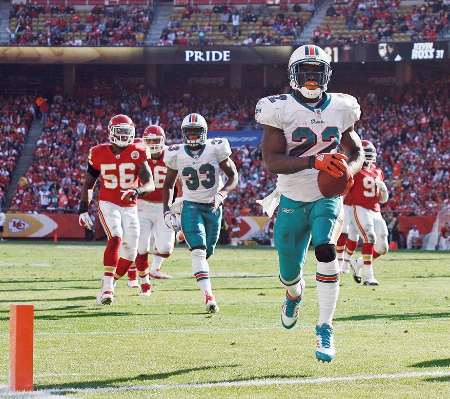 Dolphins running back Reggie Bush crosses the goal line for a touchdown during the second half. Bush ran for 92 yards. (Associated Press)