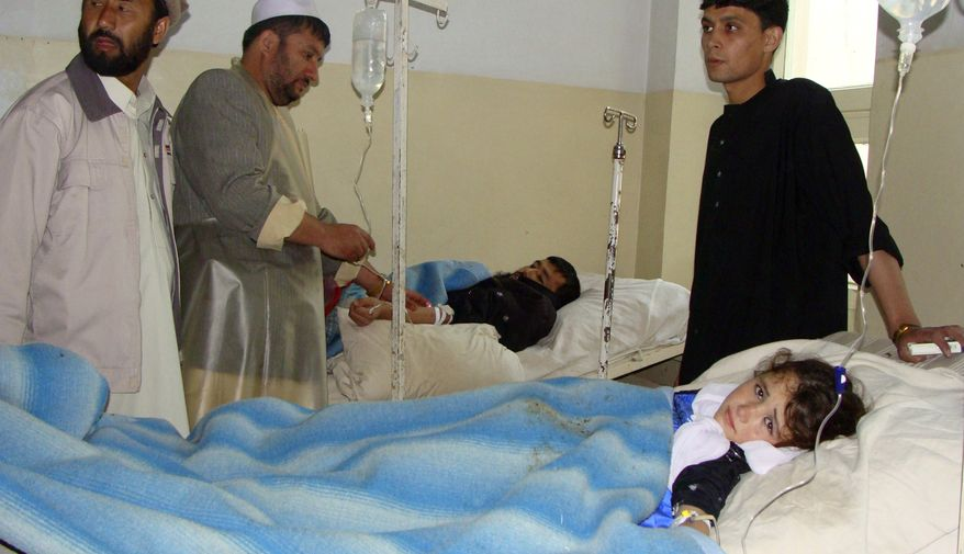 An Afghan girl who was wounded in a suicide bombing lies in a hospital bed in Baghlan, Afghanistan, on Sunday, Nov. 6, 2011. (AP Photo/Jawed Basharat)