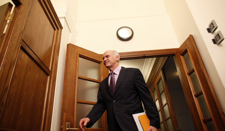 Greek Prime Minister George Papandreou arrives for a Cabinet meeting at the parliament in Athens on Sunday, Nov. 6, 2011. The country's leaders struggled for a second day to end an ongoing political crisis to ensure that Greece doesn't go bankrupt in the next few weeks and that it remains in the eurozone. (AP Photo/Kostas Tsironis)