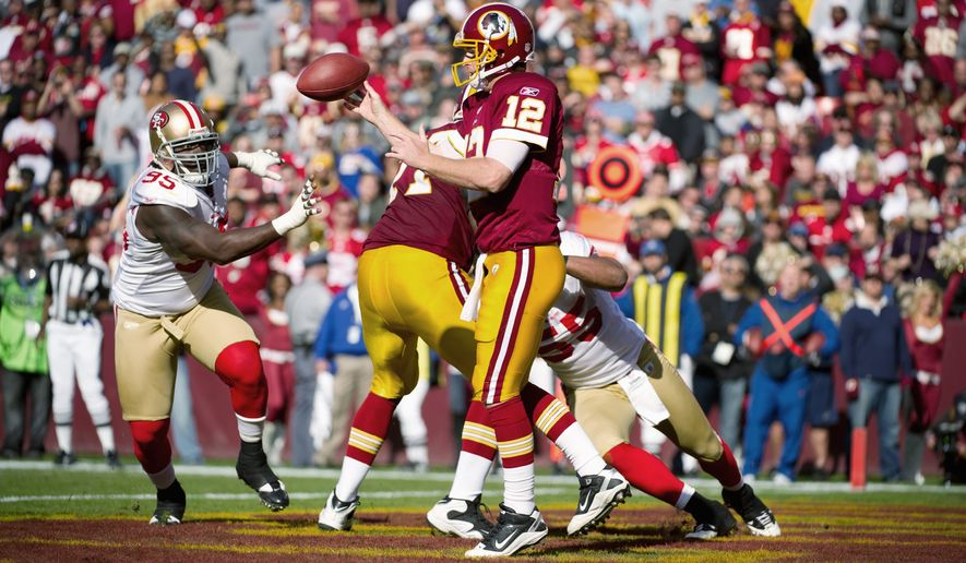 Washington Redskins QB John Beck passes from the endzone against the San Francisco 49ers at FedEx Field in Landover, Md. Sunday, November 6, 2011. Beck threw for 254 yards and had a touchdown and interception. (Andrew Harnik / The Washington Times)