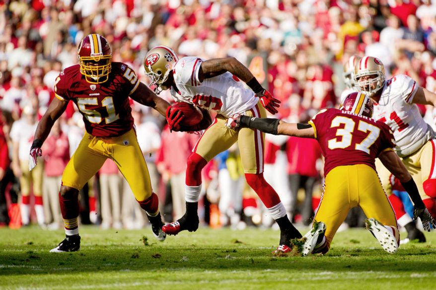 Washington Redskins Reed Doughty (37) gets a handful of San Francisco 49ers Ted Ginn Jr. (19) during a run back in the second quarter. (Andrew Harnik / The Washington Times)