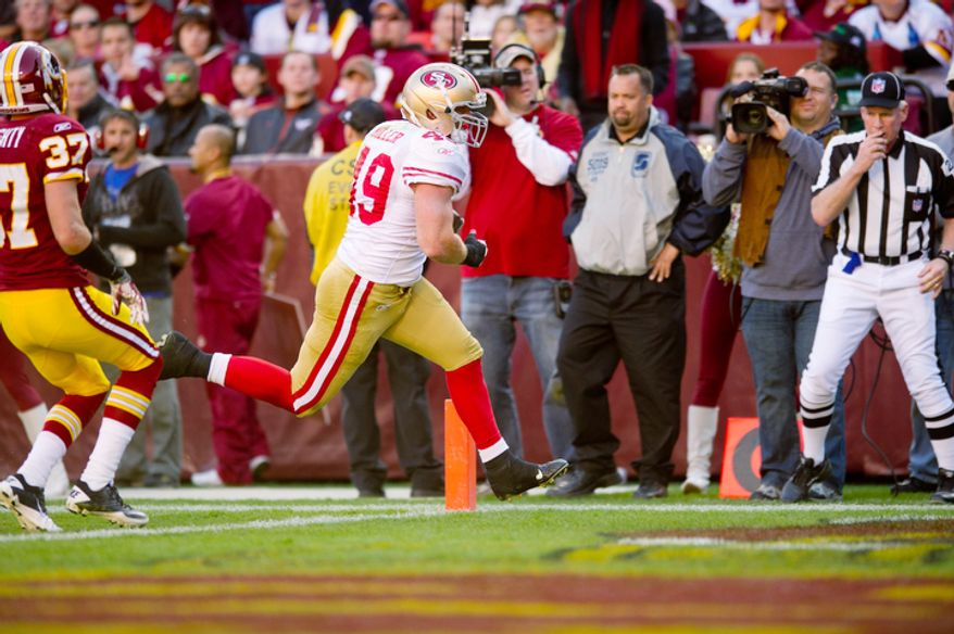 The Washington Redskins can't stop San Francisco 49ers Bruce Miller (49) from picking up a touchdown during the second quarter. (Rod Lamkey Jr. / The Washington Times)