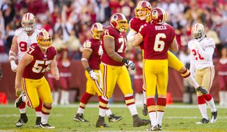 Washington Redskins Graham Gano (4) celebrates a 59-yard field goal kick against the San Francisco 49ers during the second quarter. (Rod Lamkey Jr. / The Washington Times)